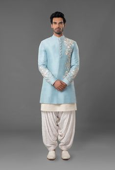 Jewelry Men Powdered Blue Raw Silk Sherwani - Sherwani is featured in powdered blue colour in raw silk fabric with white and gold thread hand embroidery. Kurta and salwar is made of ivory colour chikan fabric. Mens Indian Wear, Mens Ethnic Wear, Indian Groom Wear, Indian Men Fashion, Mens Wedding Wear Indian, Indian Male, Men's Fashion, Groom Fashion, Fashion Fail