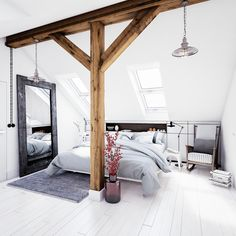 Gorgeous white attic bedroom with rustic wood beam.  Includes white wood floors.