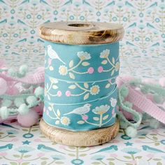 Use old wooden spools to store ribbons in a pretty way.