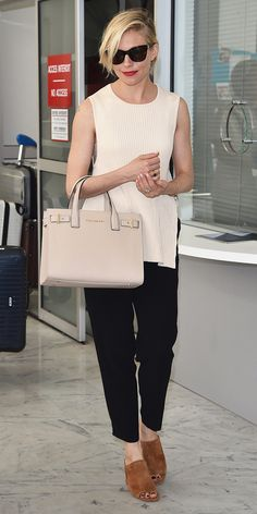 Miller epitomized sophistication in a pale knit top that she styled with tapered black trousers, a neutral tote and suede mules.