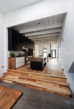 Kitchen in a narrow space. beautiful wood floors.