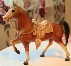 I had one of these...he looks like a cross between the Western Horse and the Western Prancer!