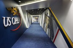 USTA Player Hallway with digital ribbon and environmental graphics. Design by Infinite Scale. Fabrication and installation by DCL. #digital #hallway #stadium #tennis #usopen