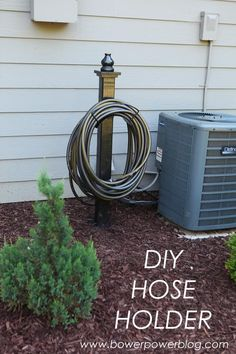 DIY garden hose holder. A clean and simple design for storing your garden hose.