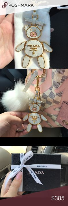 Authentic NIB Prada saffiano lady bear bag charm Brand new comes with box dustbag and original receipt - Gorgeous & so crazy adorable Authentic Prada lady bear in saffiano white and pink leather with shiny gold hardware. Hardware is hook and key and round key ring attatchment so it can be used and both a bag charm and a keychain. This is so adorable I hate to let go of it but I will for the right price. Message for further details photos or offers. Prada Accessories Key & Card Holders