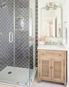 Specializing in new construction and full service interior design, Phoenix interior designer Lexi Westergard Design transforms family homes through new custom builds, remodels, and interior design services. Scallop Tiles, Bathroom Floor Tiles, Downstairs Bathroom, Master Bathroom, Transitional Bathroom, Walk In Shower, Home And Deco, Bath Remodel, Shower Remodel