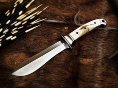 Handmade Waidblatt hunting knife by South African knife maker Louis Naude. The knife on the picture is called the Waidblatt and it has an Giraffe Bone handle. It is available from Louis Naude knives (LEO Knives). Just waiting for your choice of handle material that includes a selection of African hardwoods, synthetic materials and animal products like Giraffe bone and Buffalo horn.  Louis Naude knives ships worldwide.