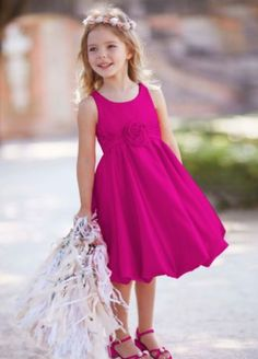 Sweet and very chic, this satin bubble dress will be perfect for your flower girl on your special day! Style KP1311 at David's Bridal.
