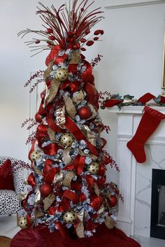 We love the lush look of this all red tree mixed with traces of leopard and cheetah print. Silver Christmas Decorations, Ribbon On Christmas Tree, Beautiful Christmas Trees, Christmas Tree Themes, Noel Christmas, Christmas Tree Toppers, Xmas Tree, Christmas Wreaths, Christmas Ideas
