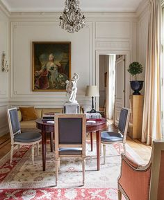 elledecor  In the breakfast room of a Buenos Aires apartment, a 17th-century Danish portrait of Crown Princess Louise of Britain overlooks a 1930s mahogany table by Frits Henningsen. The 17th-century chandelier is Swedish, the rug is an early-20th-century Oushak, the 19th-century sculpture is Gustavsberg porcelain, and the walls are painted in Benjamin Moore's Linen White. | Photo: @bjornwallander; Design: @carlosaparicio