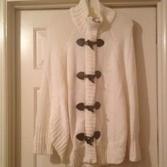 Michael Kors Nwt ivory sweater cape sz small This is a Nwt ivory Michael Kors sweater.  Never worn.  Zip closure and 4 dark brown toggle closures as well.  Stand up collar with cape style dolman sleeves. Michael Kors Sweaters Shrugs & Ponchos