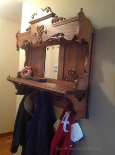 Repurposed Antique Pump Organ Hutch or organ top into a coat rack for our entry hall