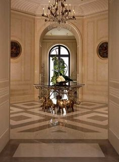Beautiful entry with hand painted paneling. What a foyer!  beautiful floor