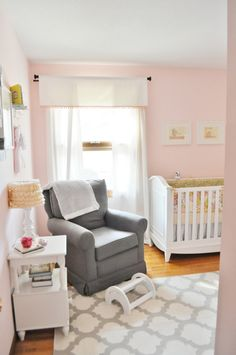 This light pink and gray nursery mixes modern and vintage - we love it!