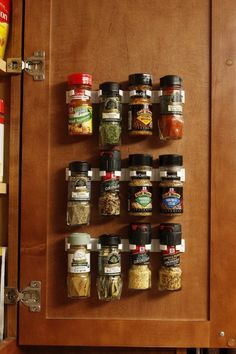 Make your cabinet into a spice rack with gripper clips that attach to the door.
