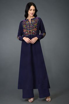 Talking Threads Signature suits are crafted in fine fabrics and adorned with exquisite embroideries. The focus is as much on embroidery design and workmanship as on the quality of construction. This Eclipse Blue long tunic k Indian Dresses, Indian Outfits, Fashion Wear, Fashion Dresses, Silk Kurti Designs, Kurti Embroidery Design, Embroidery Fashion, Mode Abaya, Wide Leg Palazzo Pants