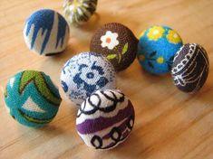 fabric-covered thumbtacks