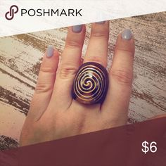 Wood ring with spiral design Wood ring (not adjustable) with painted spiral design. I have really tiny hands so this ring will look more proportioned on someone with normal/longer hands ;) BUNDLE + SAVE! Buy two or more items and get 10% off your order! Jewelry Rings