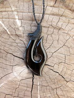 Hawaiian Makau - Ebony Wood -- *Water Friendly Exterior Coating* Approximate Measurments- 1 x x 2 (length x width x height) Fish Hook Necklace, Indian Gowns, Bone Carving, Wood Crafts, Jewelry Crafts, Chains, Hand Carved, Bones, Hand Weaving