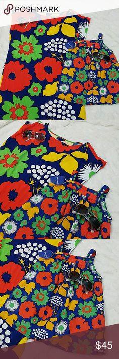 Marimekko Mommy and Me Set Medium & 3T dress Marimekko for Target Mommy & Me Dress set. Mommy dress is NWT and size Medium. has small slit on sides. Girls dress is 3T. Marimekko Dresses Mini