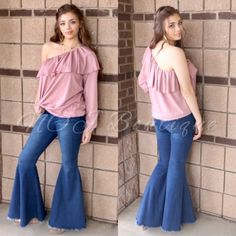 ca3eda37ea9 Be a little sassy in this light weight one sleeve ruffle top. This top is