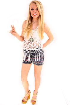 Flower Child Lace & Fringe Tank - Showcase your inner hippie with this floral lace and fringe tank. Bold yet delicate sheer floral lace alternates between larger flowers at the bodice and smaller clustered flowers at neckline, all being amplified by fringe tassels at the hem. Lastly add into the mix a detailed racer-back structure and you have a one of kind bohemian tank!  - available online at http://www.envyboutique.us/shop/flower-child-lace-fringe-tank/ #Envy #Boutique #ch
