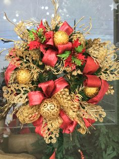 Red and gold Christmas wreath designed by Arcadia Floral & Home Decor