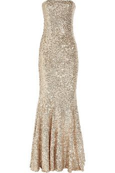 After the vows are exchanged, this sparkler is perfect for the reception.  Tulle and sequins embellish this gown, which puts you in the spotlight to dance the night away!