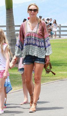 Alex Gerrard rocks a true California girl vibe in tiny denim shorts #dailymail