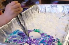 Making marbled Easter eggs with shaving cream and food dye