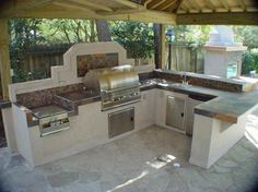 Kitchen, Prefab Modular Outdoor Kitchen Kits With Stainless Steel Barbeque Grill Stone Countertop Garden Lamp Under Wooden Trellis: Get Modular Outdoor Kitchen Kits for Your House