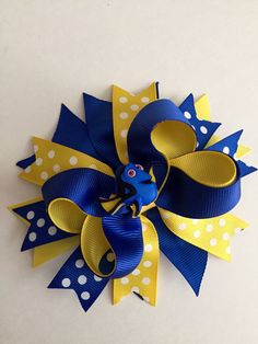 Discover thousands of images about Dorys Hair Bow. This hair bow is layered with lots of ribbon in blues and yellows. Measures approximately 5 across and comes an alligator clip. Ribbon Hair Bows, Bow Hair Clips, Ribbon Flower, Hair Bow Tutorial, Headband Tutorial, Flower Tutorial, Disney Bows, Baby Hair Bows, Boutique Hair Bows
