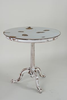 White Distressed Table with Wood Bead Detail. Shabby Chic vibe.
