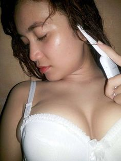 amateur hot babes wearing sexy bra making a phone call and release her nice tits