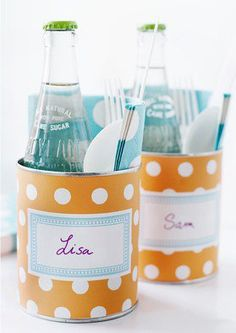 Old vegetable cans wrapped in scrapbook paper  to hold drink, napkin & utensils- cute for out of doors!
