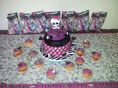 Monster High birthday cake and cupcakes. My baby girl's 9th birthday and my first time making a fondant cake!