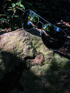 #glasses #shades #green #blue #stone #rock #reflection