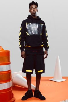 21 Savage wearing Off-White c/o Virgil Abloh Arrow Shorts, Off-White c/o Virgil Abloh Black 7 Opere Hoodie