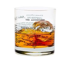 One 11 oz rocks glass showcasing the first edition inside cover and opening lines of Sir Arthur Conan Doyles The Adventures of Sherlock Holmes.  To Sherlock Holmes she is always the woman. I have seldom heard him mention her under any other name.  Looking for another novel? We have several more and other SMART gifts on our Etsy site here: https://www.etsy.com/shop/theUncommonGreen?ref=hdr_shop_menu§ion_id=13983593