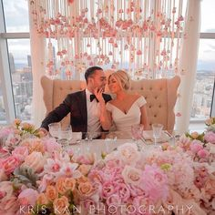 Breath taking!!! Too cute! The bride and groom share a love seat for dinner. Also love the backdrop