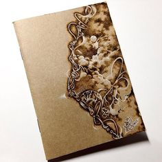 Pyrography on paper. (kraft notebook cover-passport size) with white colored pencil. #pyrography #woodburning #paperburning #Midoritravelersnotebook #custom