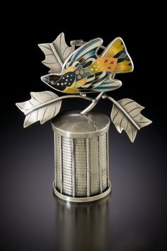 """Oriole and Poplar.""  Container, Brooch / Pendant  Cloisonne' enamel, fine and sterling silver  Roller-textured, constructed, oxidized.  By Michael Romanik"