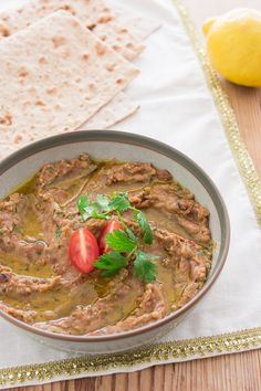 Ful Medames, an easy delicious Mediterranean dip made with fava beans, tomatoes, onions, garlic and lemon juice.
