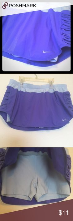 XL Nike running golf athletic skort shorts Size xl. Nike brand. Ordered a xs and received this one instead. 🙄 dark and light blue. With briefs under the skirt. Running or golfing or for athletic wear. Super cute skort though! In perfect condition. Nike Skirts
