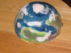How to make a miniature planet from Durham's water putty. Visit this site for how-to instructions:   http://solipsistgaming.blogspot.com/2011/05/finishing-your-planet.html