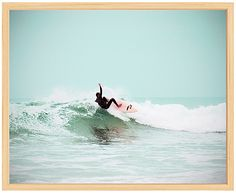 love this surfer photo and natural wood frame