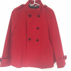 Banana Republic Coat Practically new, worn twice. Banana Republic red coat. Lined inside with black detailing. Seriously adorable on, hits right at hips. Pleat detailing in back of coat adds to a cute shape. Shell: 55% Wool 43% Polyester 2% Other Fibers. Lining: 100% Polyester. Comes with one additional button attached in lining. Banana Republic Jackets & Coats