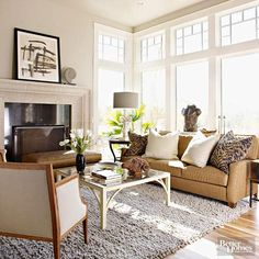 Here's proof that a color scheme made up exclusively of neutrals is anything but boring. A healthy variety of brown tones, plus black and white, create an upscale look with intrigue. The nubby rug, stone mantel and sculptures add textural depth, and all those unassuming stretches of neutral allow the patterned work of art over the mantel to take center stage.