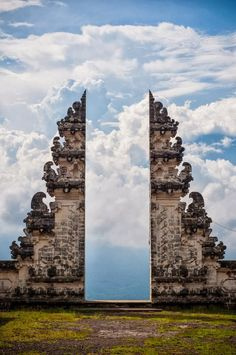 Pura Lempuyang Door, Bali, Indonesia: 'Puras are designed as an open air place of worship within enclosed walls, connected with a series of intricately decorated gates between its compounds. This is a split gate, known as candi bentar...' http://en.wikipedia.org/wiki/Balinese_temple #Indonesia #Balinese_Temple