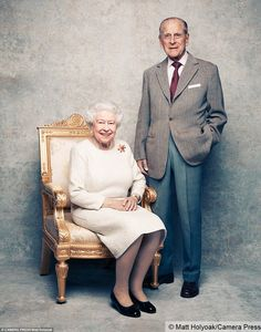 The photographs, shot at Windsor Castle, show the Queen smiling as she is seated next to her husband of seven decades. The Queen wore the yellow gold, carved ruby and diamond Sacarb brooch that was gifted to her by her husband in 1966